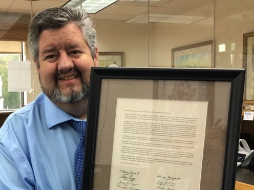Billy and Patsy's son, Gregory Scott, stopped by the UCEMC district office to receive the resolution in honor of his late father.