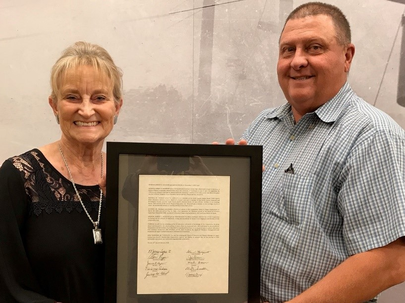 Mrs Carol Woodard with UCEMC General Manager Jimmy Gregory